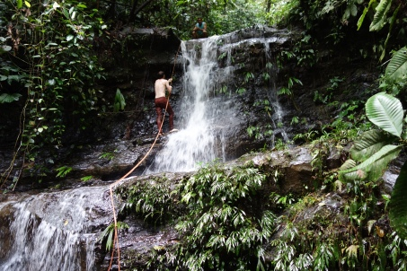 Volunteers go on the repelling waterfall hike