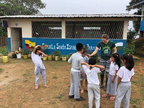 Volunteers run activities with school children