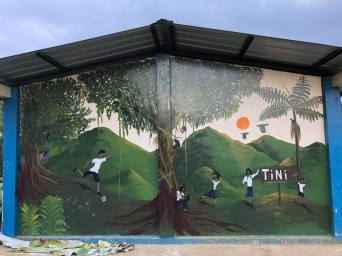 Volunteers painted a mural at the local school