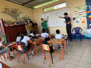 Volunteers teach English